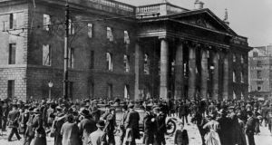 View of the crowd gathered outside the ruins of the GPO in April 1916. Photograph: Getty Images
