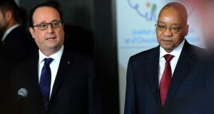 South African president Jacob Zuma (right) with French president François Hollande during a summit on health and sanitary security. Photograph: Olivier Anrigo/EPA