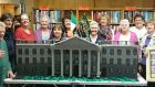 Members of the Knit & Natter group who meet every Friday at Dunmanway Library pictured with the stunning replica model of Dublin's GPO, knitted and crocheted by them. Photograph courtesy of the Southern Star