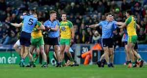 Tempers flare during the second half of the Dublin v Donegal game at Croke Park  that led to to both Donegal's Michael Murphy and Dublin's James McCarthy to be sent off for  receiving second yellow cards. Photograph:  Donall Farmer/Inpho