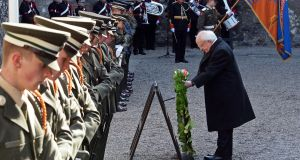 President Higgins lays a wreath in the Stone Breakers' yard in Kilmainham Gaol where rebels were executed in 1916. Photograph: Eric Luke / The Irish Times