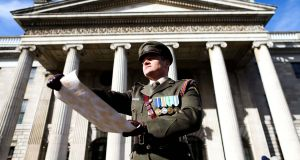 Captain Peter Kelleher from the 27th Infantry Battalion, reading the Proclamation at the GPO. Photograph: Maxwells/PA Wire/Handout