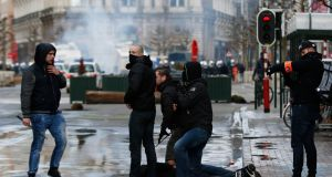 A right wing demonstrator is detained by police following a protest at the site of one of the memorials to the victims of the recent Brussels attacks. Photograph: AP