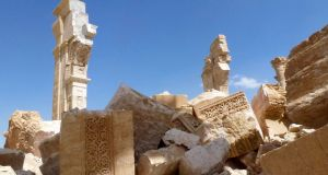 A general view taken yesterday shows part of the remains of the Arc de Triomph monument in Palmyra. Photograph: Al Mounes/AFP/Getty Images