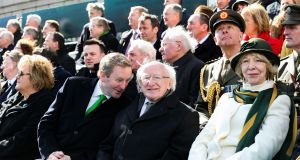 Acting Taoiseach Enda Kenny chats to President Michael D Higgins at the Easter Sunday commemoration ceremony and parade from O'Connell Street, Dublin. Photograph: Maxwells