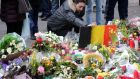 People gather in the Place de la Bourse in Brussels to pay tribute to the  victims of the attacks  last week. Photograph:  Sylvain Lefevre/Getty Images