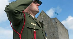 Corp Richard King of Dún Uí Mhaoilíosa, Renmore Barracks, Galway, salutes during the playing of the National Anthem at the Athenry 1916 Centenary Commemoration on Easter Monday. Photograph: Joe O'Shaughnessy.