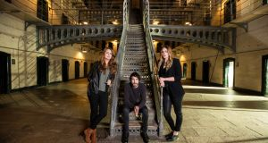 Aoife Scott, left, whose debut album appeared on Fund It, with her cousins Danny O'Reilly and Róisín O in Kilmainham Gaol as part of RTÉ's 1916 commemorations.