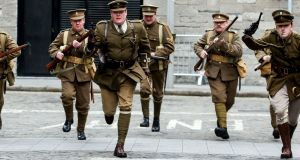Members of the Irish Great War Society acting out a scene from the Rising in Smithfield, Dublin. Photograph: Maxwells
