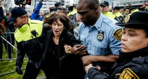 Florence Hartmann, former spokeswoman of the International Criminal Tribunal for Former Yugoslavia, being arrested last Thursday before the reading of the verdict of Bosnian Serb wartime leader Radovan Karadzic in The Hague. Photograph: Robin van Lonkhuijsen/AFP/Getty Images
