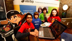 At the launch of the fifth CoderDojo Coolest Project awards at the CHQ in Dublin were, from left, Dhruv Bhamidipati, Dublin 8, Jasper and Harvey Brezina-Conniffe, Glen O' the Downs, Wicklow,  and Grainne Meghan, Killiney. Photograph: Cyril Byrne/The Irish Times