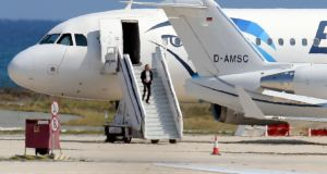 A man believed to be the hijacker of the EgyptAir Airbus 320 leaves the plane  before surrendering to security forces after a seven-hour standoff at Larnaca airport, Cyprus. Photograph: AFP/Getty Images
