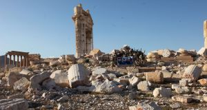 Syrian soldiers inside the historical city of Palmyra, Syria. Photograph: EPA.
