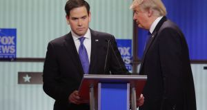 Marco Rubio and Donald Trump: Trump retweeted a photo posted last week by a supporter mocking the appearance of Rubio's wife. Photograph: Chip Somodevilla
