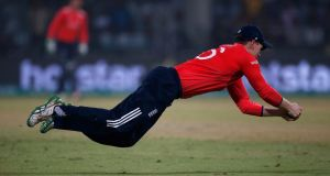 England's captain Eoin Morgan dives to take a catch to dismiss New Zealand's Ross Taylor in the  World Twenty20  semi-final at the Feroz Shah Kotla cricket ground  in New Delhi . Photograph:  Adnan Abidi/Reuters