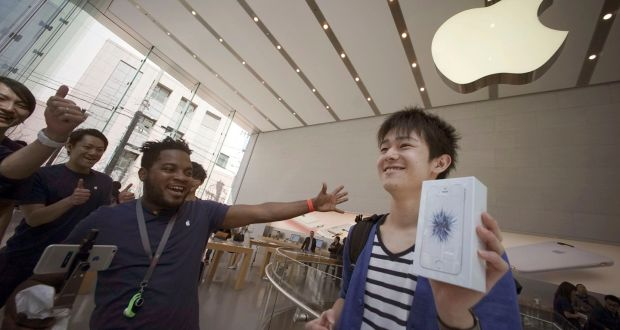 One of the first customers picks up a Apple's new iPhone SE, which went on sale in selected markets today