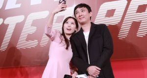 Wang Sicong poses for a selfie with a fan: the son of Wanda chairman Wang Jianlin posted pictures on social media of his dog wearing two gold Apple watches. Photograph: ChinaFotoPress/Getty Images