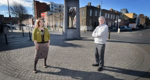 Irene Crawley and Joe Dowling from Hands on Peer Education (Hope) at the memorial on the corner of Seán McDermott Street and Buckingham Street in Dublin.   Photograph: Alan Betson