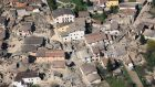 An aerial view of the destruction in the city of L'Aquila, central Italy, caused by the earthquake of April 2009. Photograph: AP/Italian Forestry Police Force