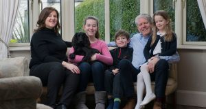 Jonny Quigley, who has had a kidney transplant,  with his wife Clodagh, and children Hannah (12, with Jules the dog), Charlie (10), and Rachael (7). Photograph: Dave Meehan/The Irish Times