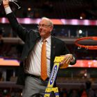 Syracuse Orange head coach Jim Boeheim waves to the crowd after cutting down the net after defeating the Virginia Cavaliers in the championship game of the midwest regional of the NCAA Tournament at the United Center. Photograph: Dennis Wierzbicki/Usa Today Sports
