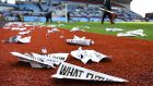 Protest banners scattered on the pitch after the Barclays Premier League match between Aston Villa and Chelsea at Villa Park. Photograph: Shaun Botterill/Getty Images