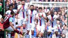 The Crystal Palace wall prepares to jump to block West Ham United's French midfielder Dimitri Payet's freekick but cannot prevent him. Photograph: Getty Images