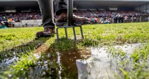 A stewart tries to clear water before the Roscommon and Mayo game in Hyde Park last weekend. Photograph: James Crombie/Inpho