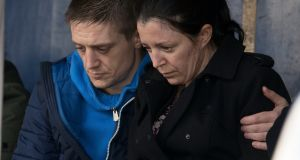 Louise James is comforted by her brother Chris at a vigil in Buncrana. Photograph: North West Newspix