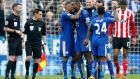 Leicester City's Danny Simpson, Wes Morgan, Kasper Schmeichel, Christian Fuchs and Nathan Dyer celebrate at full time. Photo: Carl Recine/Reuters