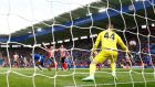 Leicester City's Wes Morgan's beats Southampton keeper Frazer Forster with a downward header to score the winning goal in yesterday Premiership clash at the King Power Stadium. Photograph: Darren Staples/Reuters