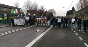 Protesters outside St Vincent's secondary school. Photograph: Conor Lally