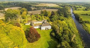 Bective House, aerial shot indicates poor condition of house and buildings, and its magnificent surroundings