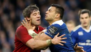 Munster's Dave O'Callaghan tackles Leinster's Ben Te'o. Saturday's match at the Aviva Stadium lacked the sense of occasion associated with previous  high-octane meetings. Photograph: Billy Stickland/Inpho