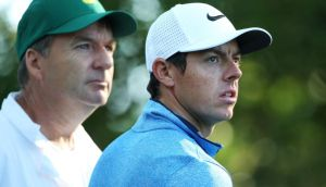 AUGUSTA, GEORGIA - APRIL 05:  Rory McIlroy of Northern Ireland and his caddie J.P. Fitzgerald stand on the second tee during a practice round prior to the start of the 2016 Masters Tournament at Augusta National Golf Club on April 5, 2016 in Augusta, Georgia.  (Photo by Andrew Redington/Getty Images)