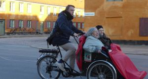 Helle, on the left, and Birthle go for a cycle with their  pilot,  Theis. Photograph: Derek Scally