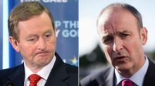 Acting taoiseach Enda Kenny (left) has formally asked Micheál Martin to participate in a 'full partnership' government along with Independent TDs.
