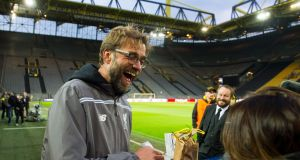Liverpool's coach Jurgen Klopp signs autographs during a training session at Signal Iduna Park in Dortmund. Photograph: EPA
