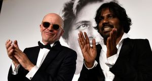 Jacques Audiard and Dheepan star Jesuthasan Antonythasan  after winning the Palme d'Or  on May 24, 2015. Photograph:  Pool/Getty Images