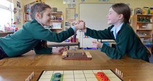 Emma de Bustos (11) and Emily McCann (10) playing the board game Quoridor at Rathdown Junior School, Glenageary. Photograph: Eric Luke