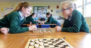 Charlotte Mitchell (11) and Aoife Galvin (11) playing checkers at Rathdown Junior School, Glenageary . Photograph: Eric Luke