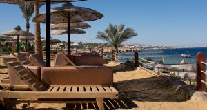 Vacant beach chairs at the Egyptian tourist resort of Sharm el-Sheikh. Photograph: Chris McGrath/Getty Images
