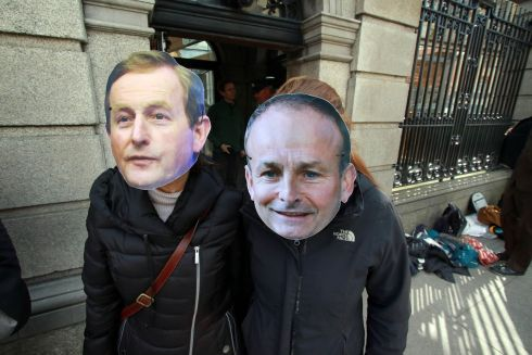 Wednesday: Participants in the Robinhoodtax.ie protest wearing masks of acting Taoiseach Enda Kenny and Fianna Fail leader Micheal Martin.  Photograph: Nick Bradshaw  /The Irish Times