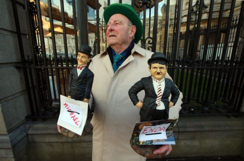 WEDNESDAY: Protester Peter Cryan from Leitrim outside the Dail with his Laurel and Hardy figurines as Micheal (Martin) and Enda (Kenny).   Photograph: Nick Bradshaw  /The Irish Times