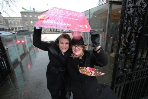 WEDNEDAY: Senate candidate Sabina Brennan, who is highlighting the needs of the elderly, with Helen Rochford Brennan, chairperson of the Dementia Working Group, caught in a shower outside the Dail. Photograph: Nick Bradshaw  / The Irish Times