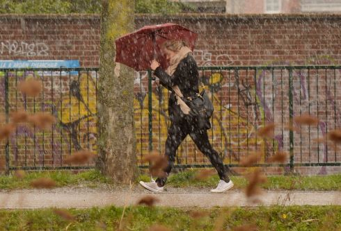 WEDNESDAY: A pedestrian walking along the banks of the Grand canal at Leeson Street during a hailstone shower.   Photograph: Alan Betson / The Irish Times