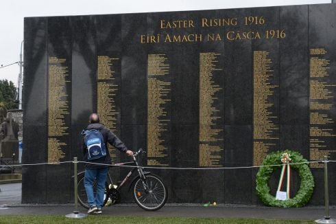 MONDAY: Taking a close look at the Remembrance Wall at Glasnevin Cemetery. Photograph: Cyril Byrne / The Irish Times