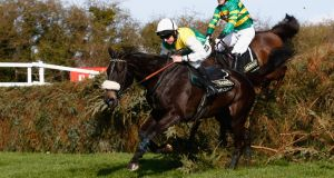 Many Clouds ridden by Leighton Aspell on his way to winning the Crabbie's Grand National at Aintree last year. Photograph: Clive Rose/Getty Images