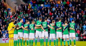 The Northern Ireland team observe a minute's silence for the Buncrana Pier  victims. Photograph: Kevin Scott/Presseye/Inpho
