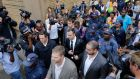 Oscar Pistorius (centre) is surrounded by security personnel as he leaves the High Court after the third day of his murder trial, in Pretoria, South Africa on March 5th, 2014. File photograph: Kim Ludbrook/EPA